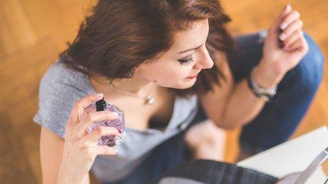 Lady using perfume